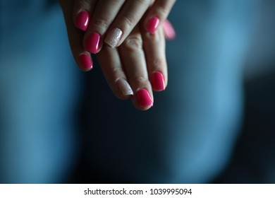 Colorful nails of a woman hand beauty fingernail in pink