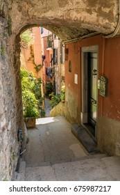 colorful narrow alley in Vernazza, Cinque Terre, Liguria, Italy