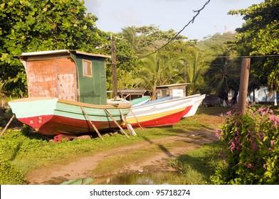 colorful native fishing boats in tropical jungle Big Corn Island Nicaragua