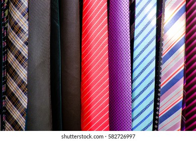 Colorful necktie hanging for sale in shop. abstract background