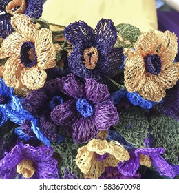 Colorful needle work flowers as a background
