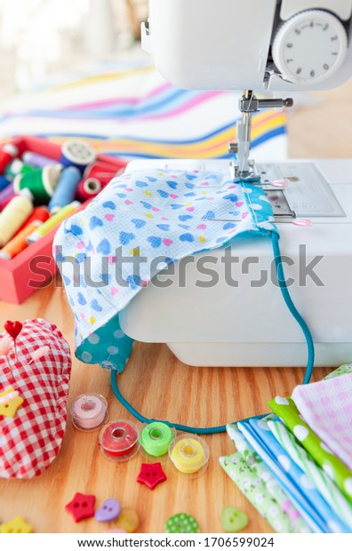 Colorful needlework utensils with cottan fabrics and yarns