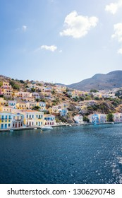 Colorful neoclassical houses in harbor town of Symi (Symi Island, Greece)