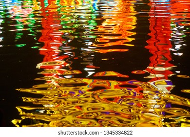 Colorful neon reflections in dark water.