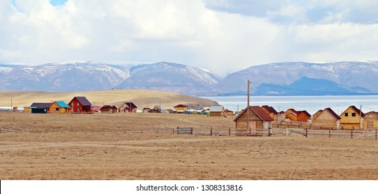 Colorful new wooden cottage in a villa of Olkhon island, taken while car driven pass