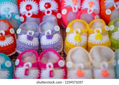 Colorful newborn small crochet shoes.