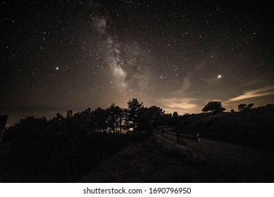 Colorful night landscape Milky Way over the mountains in the starry sky with hills in summer.