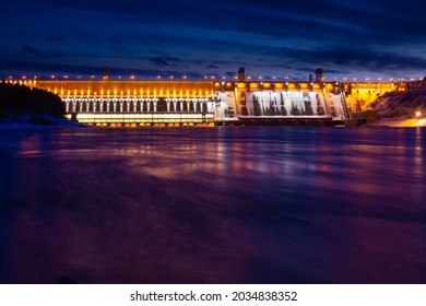 Colorful night lights of an illuminated Krasnoyarsk Dam, Russia. Bright view on hydroelectric power station at dusk