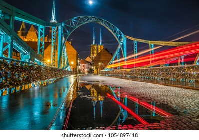 Colorful night scene on Wroclaw Lovers Bridge. Cathedral with reflection in historical capital of Silesia, Poland, Europe. Artistic style post processed photo.