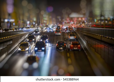 colorful night traffic, evening city with traffic lights