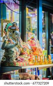 Colorful night view of indian gods sculpture at Sri Maha Mariamman Temple, also known as Maha Uma Devi temple, the public hindu temple in Silom, Bangkok, Thailand. It known as Wat Khaek Silom.
