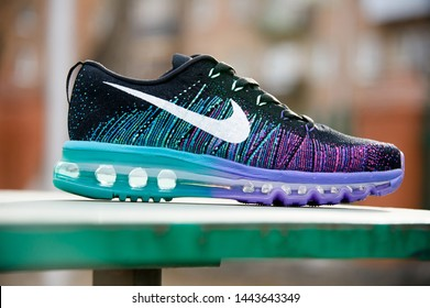 Colorful Nike Flyknit Air Max running shoes, sneakers, trainers close up view, shot on abstract background. Sport and casual footwear concept. Krasnoyarsk, Russia - Februsry 14, 2015