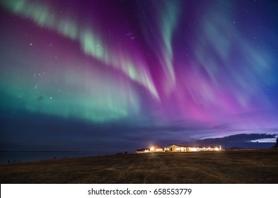 colorful northern lights on a icelandic beach