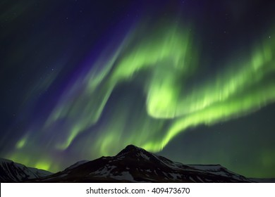 Colorful Northern Lights over mountains