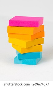 Colorful note pads stacked up.