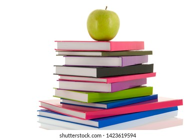 colorful notebooks with green apple isolated over white background