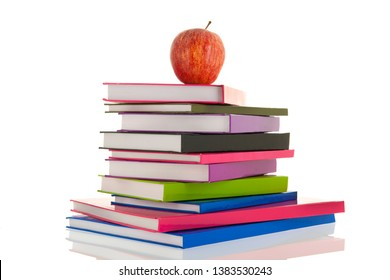 colorful notebooks with red apple isolated over white background