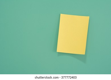 Colorful notes paper on green background