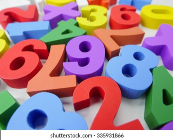 Colorful numbers on white background.