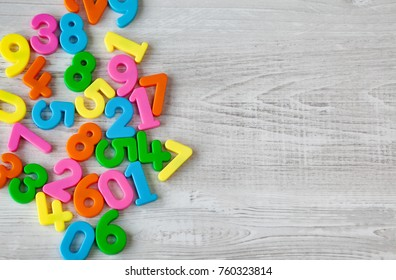 Colorful numbers on wooden grey background.