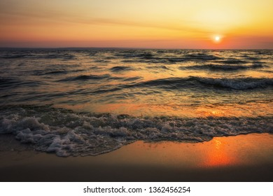 Colorful ocean beach sunrise. Dawn over the sea. Nature composition