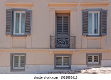 colorful ocher and gray house exterior, Plaka old neighborhood, Athens Greece