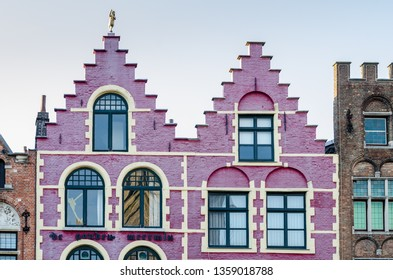 Colorful old brick house on the Grote Markt square in the medieval town of Bruges, Belgium.