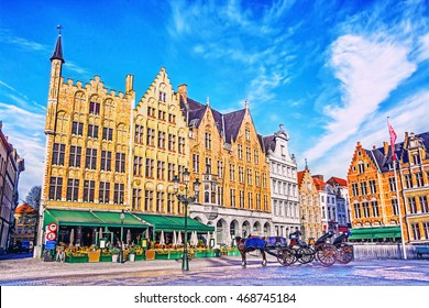 Colorful old brick house on the Grote Markt square in the medieval town of Bruges, Belgium