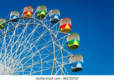 A colorful old ferris wheel awaits riders in Sydney, Australia.
