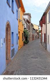 colorful old houses street Rimini Italy summer season