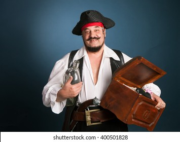 Colorful old pirate with a treasure chest