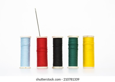 Colorful old style threads on isolated white background