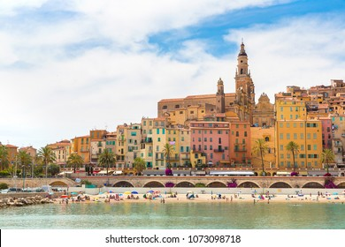 Colorful old town and beach in Menton on french Riviera in a beautiful summer day, France