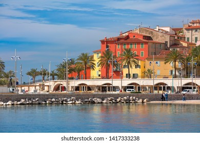 Colorful old town and beach in sunny Menton, perle de la France, on French Riviera, France