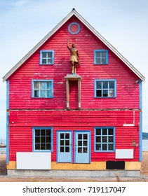 Colorful old wooden building with an Indian statue
