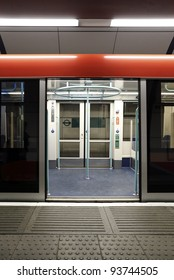 A colorful opened sliding mechanical door of the London Underground train at a tube station waiting for passenger.