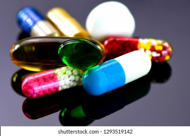 Colorful of oral medications on dark background. Capsule and tablet oral dosage form.