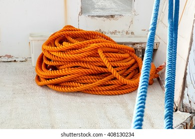 Colorful orange and blue rope on the sailboat