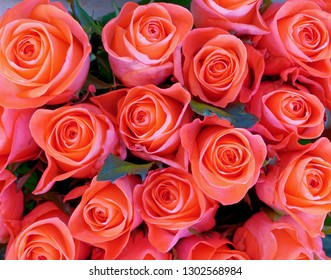 colorful orange roses bouquet top view, soft and airy natural background
