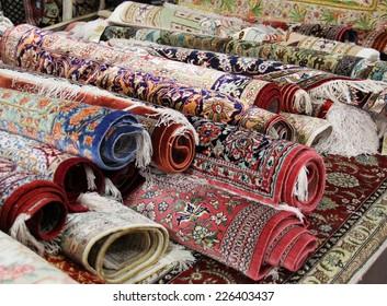 Colorful oriental carpet sale at market