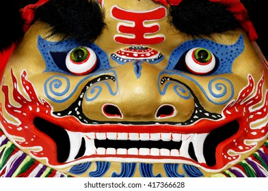 Colorful oriental dragon face used in Asian celebrations.