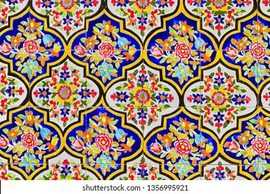 Colorful oriental geometric design and pattern commonly met in Persian mosques and medresses. Isfahan, Shiraz, Teheran, Iran