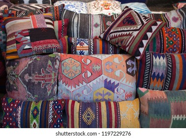 Colorful oriental pillows for sale at local middle eastern market. Shopping in Istanbul, Turkey