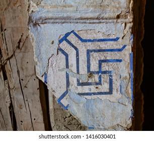 colorful ornamental tiles at moroccan courtyard swastika