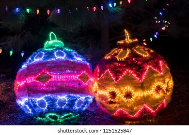 Colorful outdoor Christmas Holiday Light display with large brightly lit ornaments