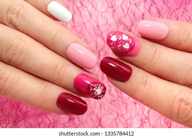 Colorful oval pink and Burgundy manicure with hearts.