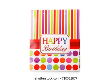 A colorful package with red, yellow and pink stripes and a signification happy birthday isolated on a white background.