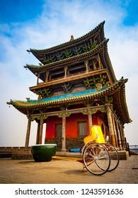Colorful pagoda build on top of the massive city walls of Pingyao, Shanxi, China