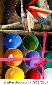 colorful paint bucket and paint brushes