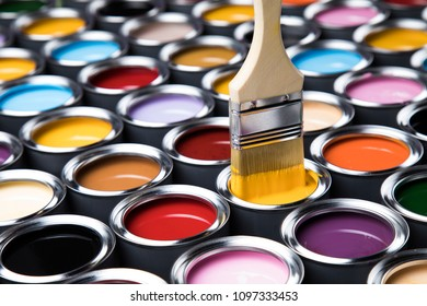 Colorful paint cans with paintbrush